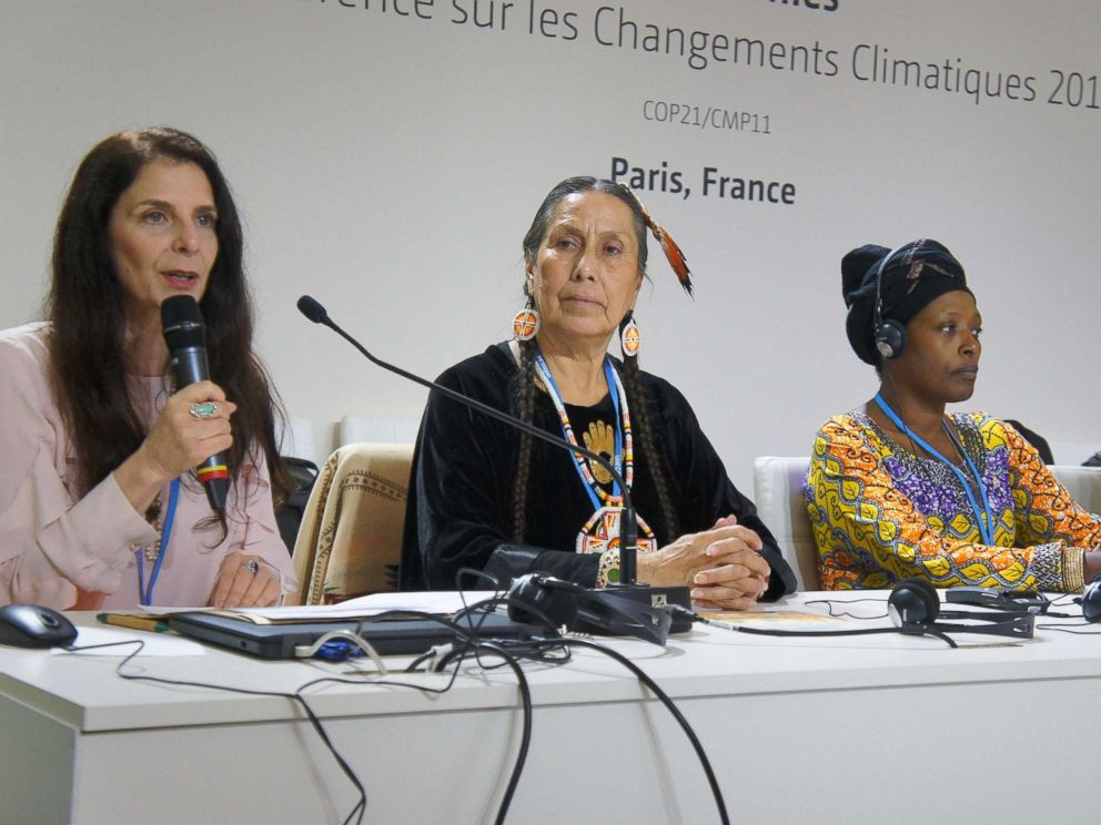 PHOTO: Osprey Orielle Lake, left, opens a WECAN International panel at the United Nations climate talks, alongside Casey Camp Horinek of Ponca Nation, U.S., and Neema Namandu of Hero Women Rising/SAFECO, DR Congo.
