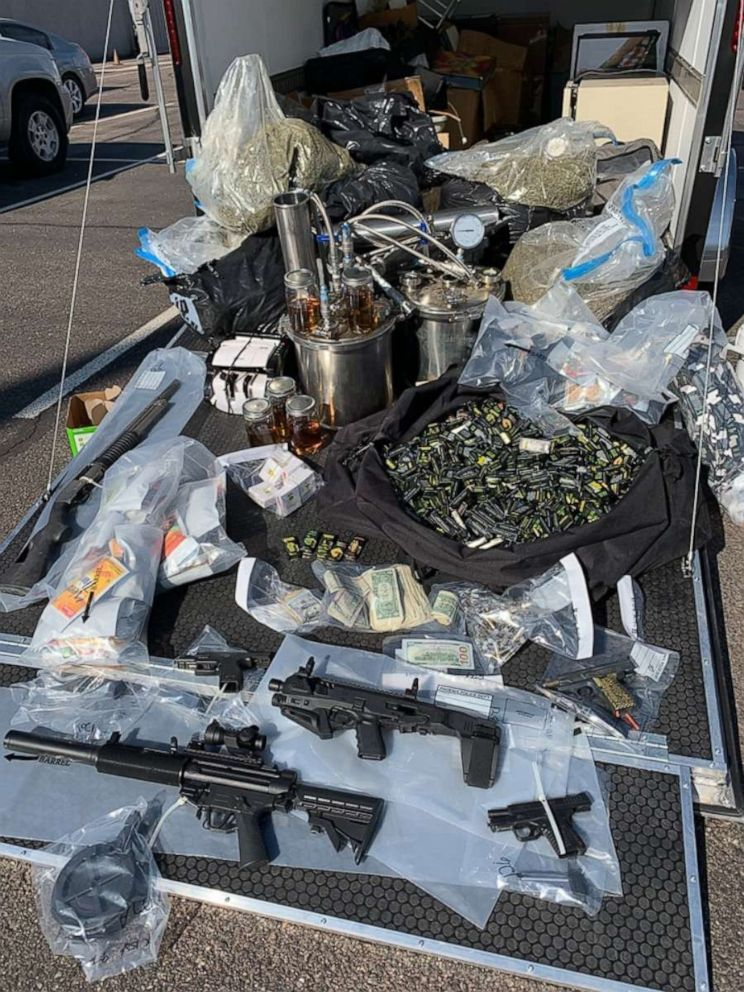PHOTO: Guns, thousands of THC vaping cartridges, 300 pounds of marijuana and thousands in cash were seized from an alleged drug house in Phoenix on Thursday, Sept. 12, 2019.