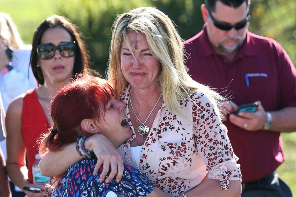 PHOTO: Women cry in an area where parents wait for news after reports of a shooting at Marjory Stoneman Douglas High School in Parkland, Fla., on Feb. 14, 2018.