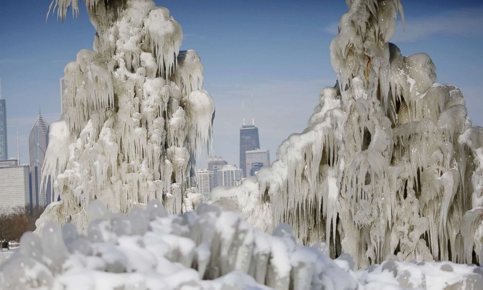 PHOTO: Downtown Chicago skyline is seen through ice-covered trees on Northerly Island, Jan. 18, 2018. Extreme cold weather hit the midwest this past week with many trees along the lakefront covered with icicles.