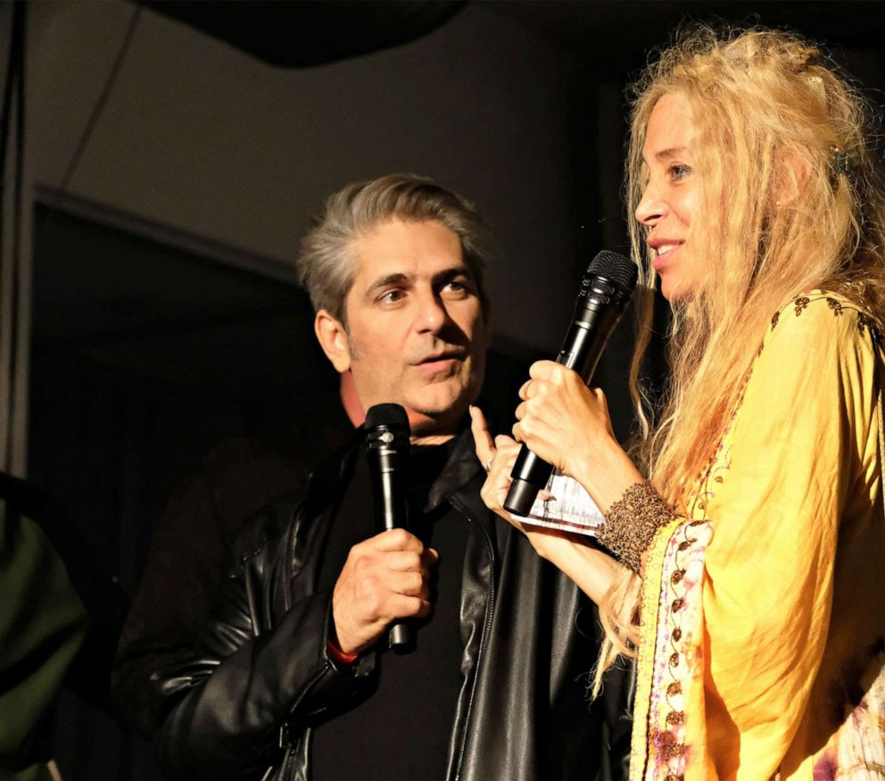 PHOTO: Wendy Oxenhorn onstage at the Apollo Theater with actor Michael Imperioli.
