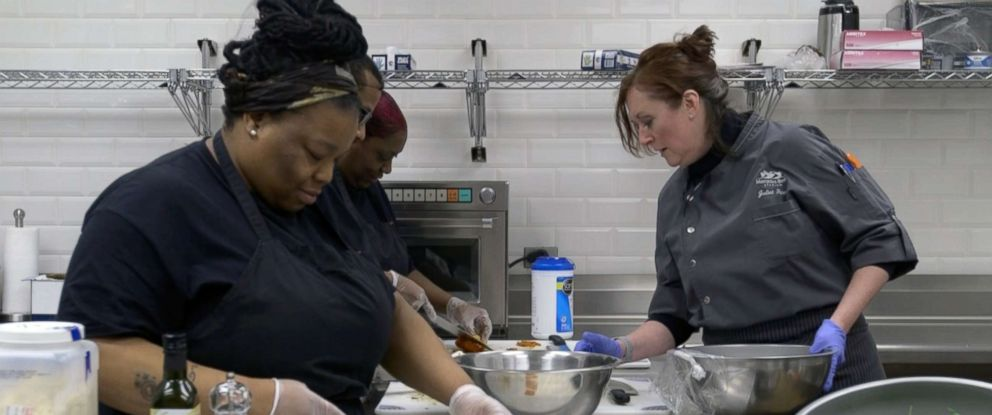 PHOTO: Westside Works culinary students practice their food preparation techniques.