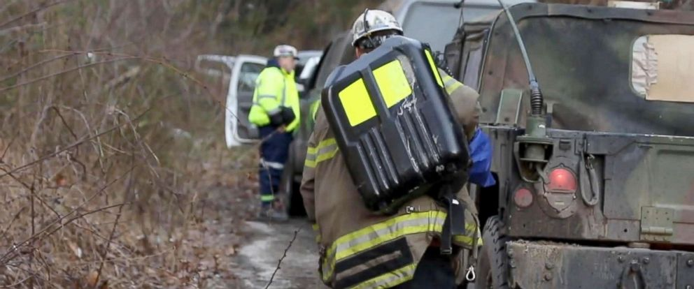 PHOTO: Rescue personnel work to relieve people trapped at the Rock House Powellton mine in West Virginia.