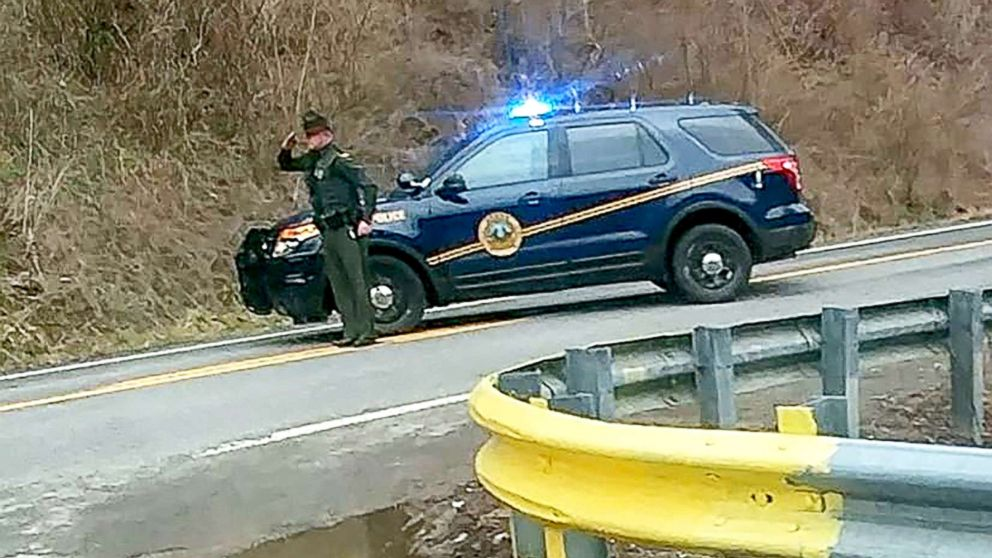 Woman posts inspiring photo of West Virginia State trooper saluting funeral procession thumbnail