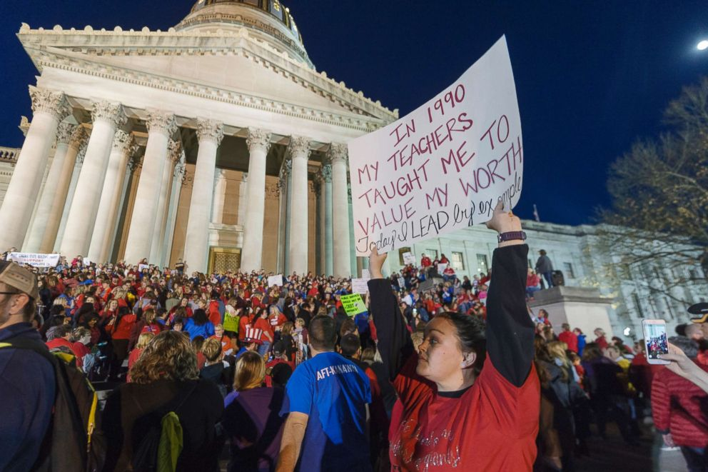 PHOTO: Jennyerin Steele Staats, a special education teacher holds her sign aloft outside of the capitol building on Feb. 27, 2018, in Charleston, W.Va. <p itemprop=