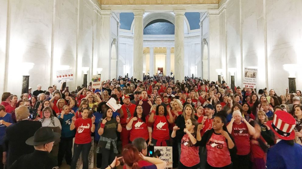 Teachers celebrate after West Virginia Gov. Jim Justice and Senate Republicans announced they reached a tentative deal to end a statewide teachers' strike by giving them 5 percent raises in Charleston, W.Va., March 6, 2018.