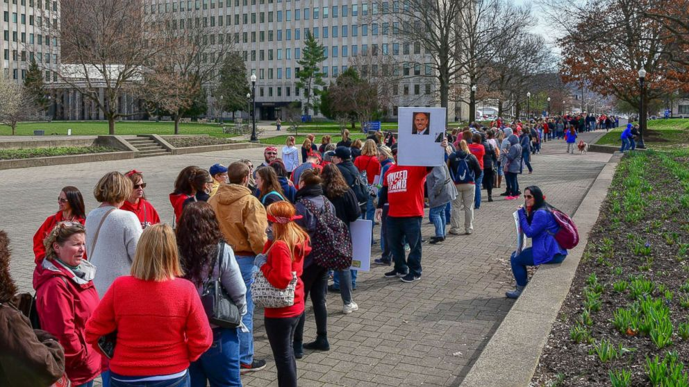 Hundreds of teachers wait in a line to enter the State Capitol, March. 5, 2018, in Charleston, W.V. Hundreds of teachers from 55 counties are on strike for pay raises and better health benefits.