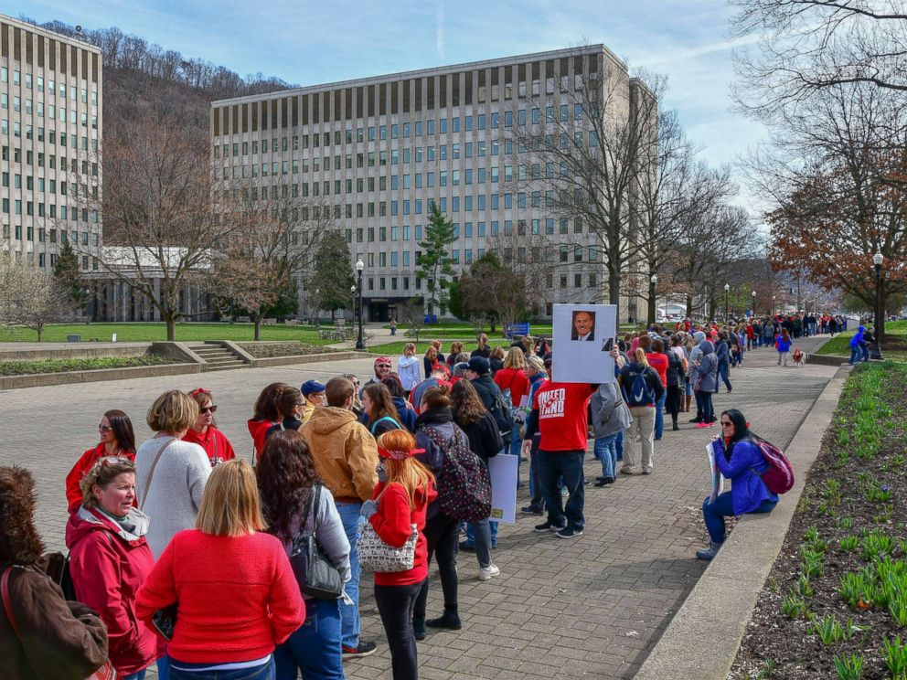 PHOTO: Hundreds of teachers wait in a line to enter the State Capitol, March. 5, 2018, in Charleston, W.V. Hundreds of teachers from 55 counties are on strike for pay raises and better health benefits.