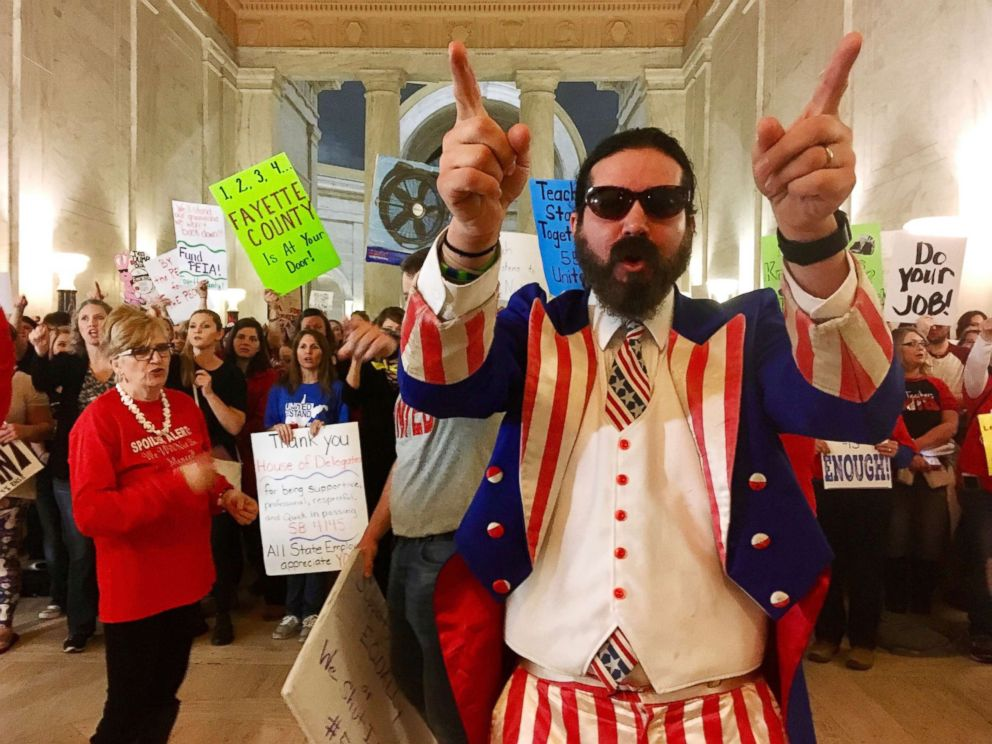 PHOTO: Parry Casto, a fifth grade teacher at the Explorer Academy in Huntington, W.Va., dressed in an Uncle Sam costume leads hundreds of teachers in chants outside the state Senate chambers at the Capitol in Charleston, W.Va., March 1, 2018.