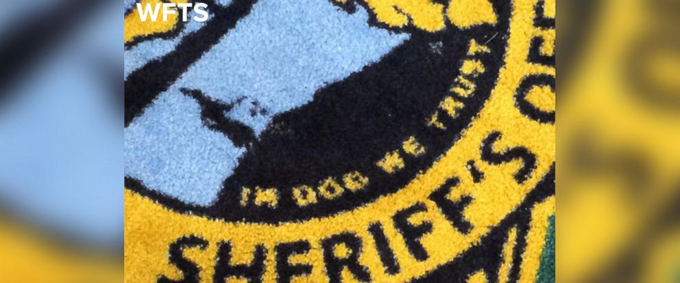 """PHOTO: WFTS in Tampa Bay, Fla. reports that the Pinellas County Sheriffs Office received a new rug with a typo that appears to read, """"In Dog We Trust."""""""