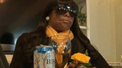 Woman Holds Court at Own Funeral with Glass of Beer