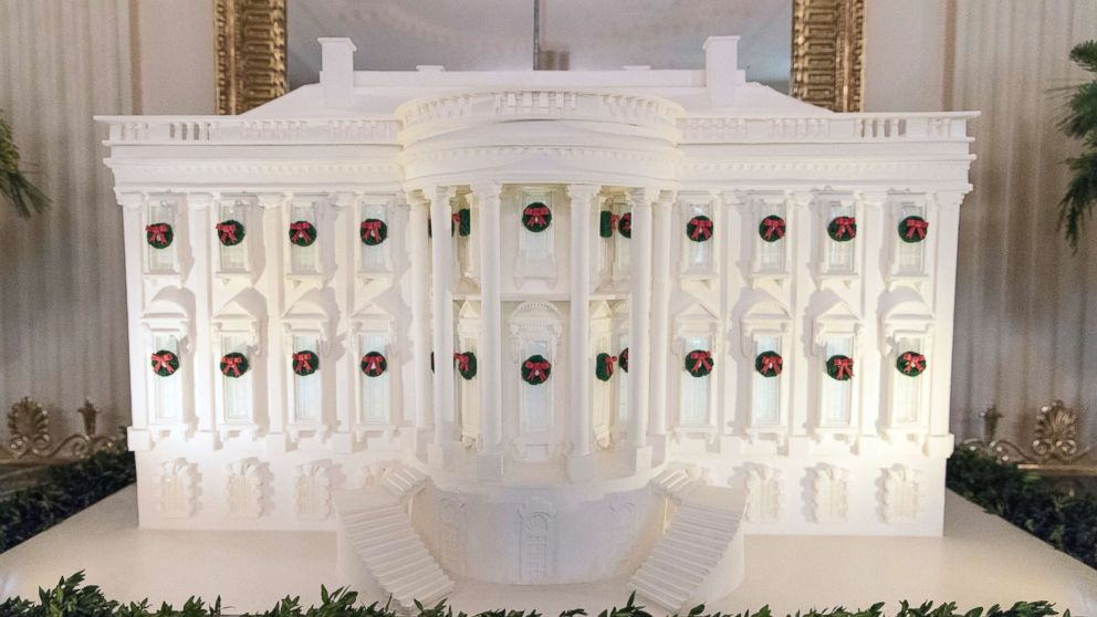 The gingerbread White House stands in the East Dining Room during a media preview of holiday decorations at the White House, Nov. 27, 2017.