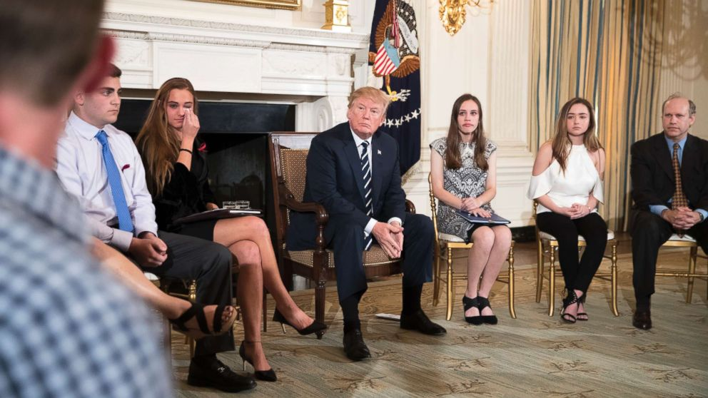 Marjory Stoneman Douglas High School shooting survivor Samuel Zeif, left, speaks to President Trump during a listening session with high school students and teachers, at the White House in Washington, Feb. 21, 2018.
