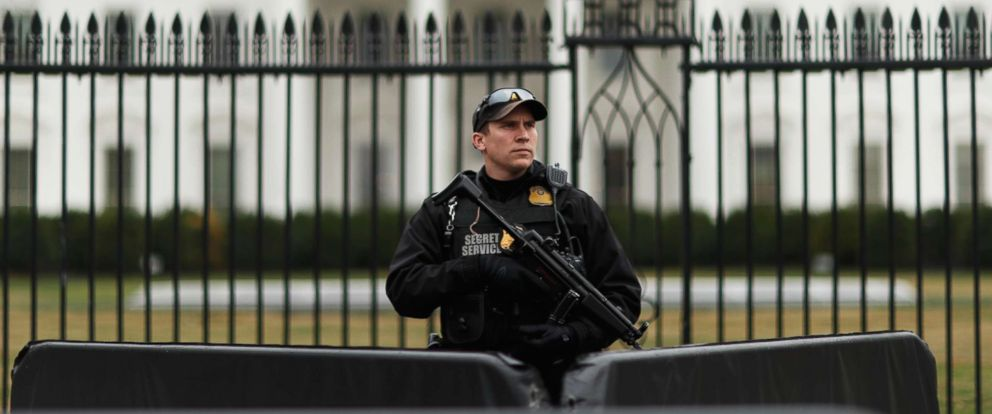 PHOTO: A uniformed Secret Service officer stands guard in front after a passenger vehicle struck a security barrier near the White House in Washington, Feb. 23, 2018.