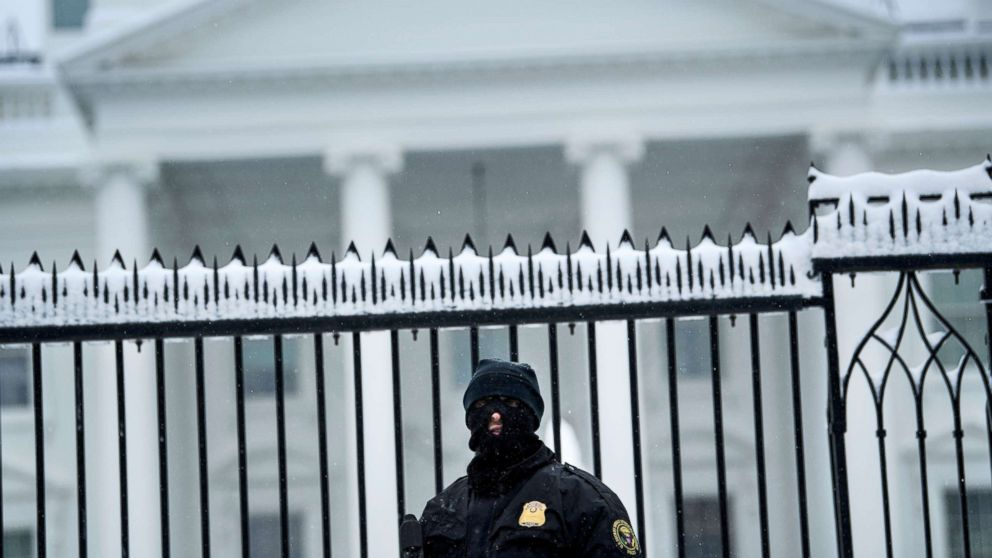 A member of the Secret Service stands guard outside the White House, Jan. 13, 2019, in Washington.
