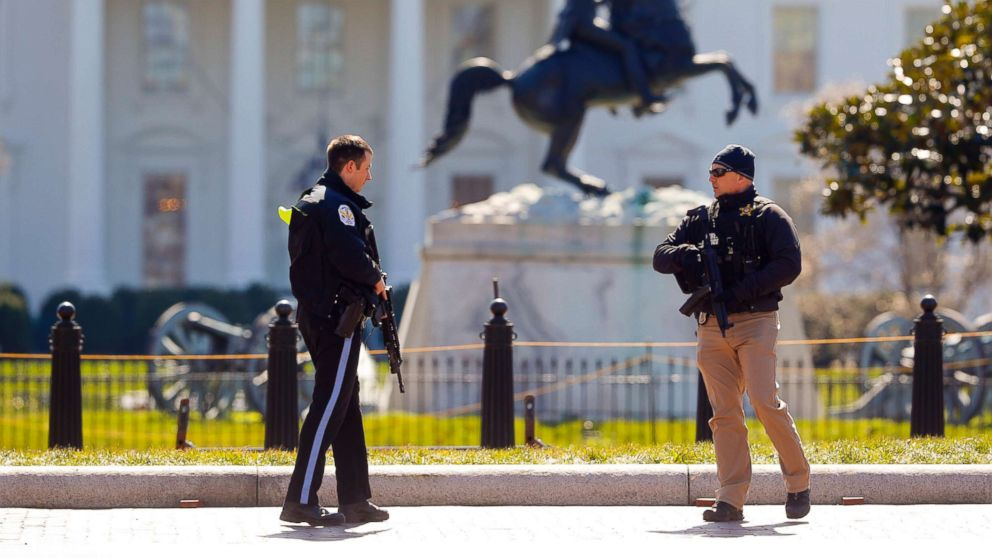 Law enforcement officers at Lafayette Park across from the White House in Washington, close the area to pedestrian traffic, March 3, 2018.