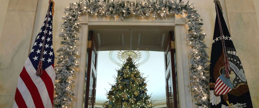 "PHOTO: The official White House Christmas tree stands in the Blue Room at the White House during a press preview of the 2017 holiday decorations, Nov. 27, 2017. The theme of the White House holiday decorations this year is ""Time-Honored Traditions."""