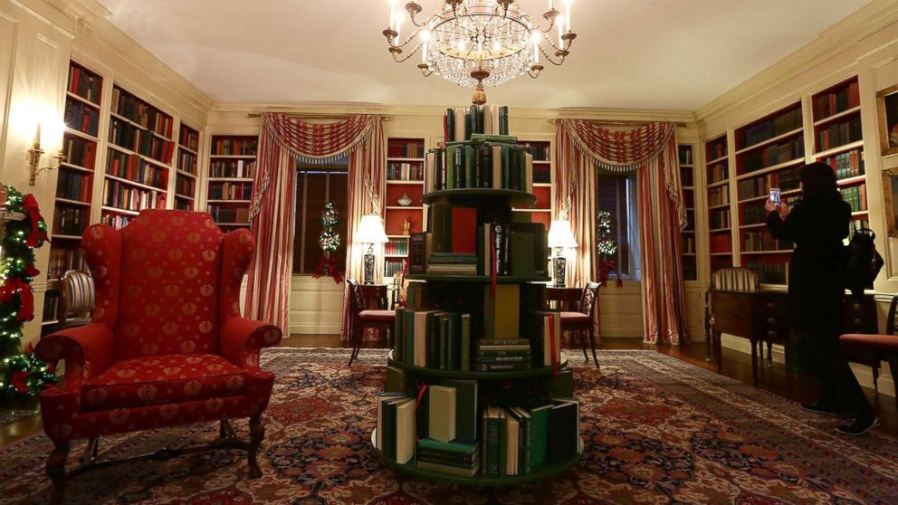 The library at the White House with a tree made of books, during a press preview of the 2017 holiday decorations Nov. 27, 2017.