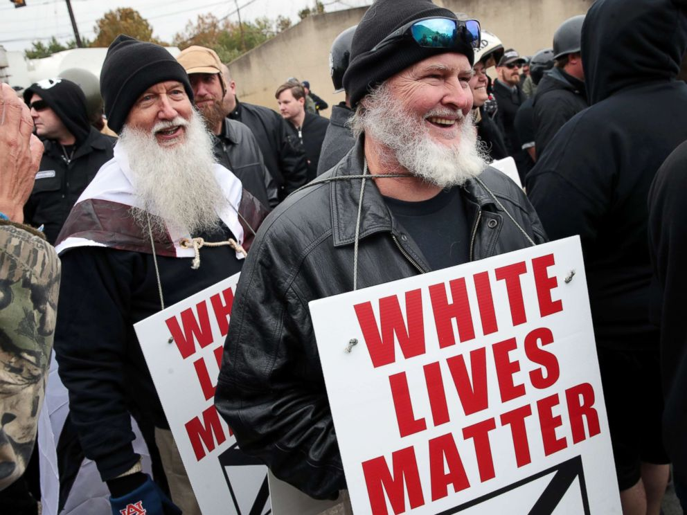 PHOTO: People hold signs during a white nationalist rally rally on October 28, 2017 in Shelbyville, Tenn.