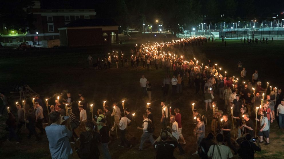 White nationalists and white supremacists carrying torches marched in a parade through the University of Virginia campus, Aug. 11, 2017.