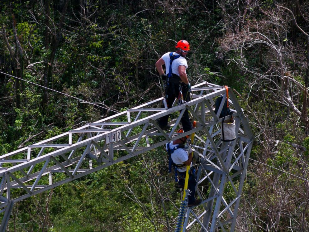 PHOTO: Whitefish Energy Holdings workers restore power lines damaged by Hurricane Maria in Barceloneta, Puerto Rico, Oct. 15, 2017.