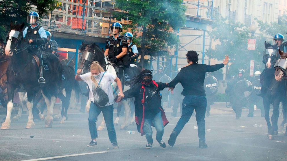 PHOTO: Protesters are tear gassed as police work to disperse them outside the White House, June 1, 2020, before President Trump walked over to St. John's Episcopal Church for a photo-opportunity.