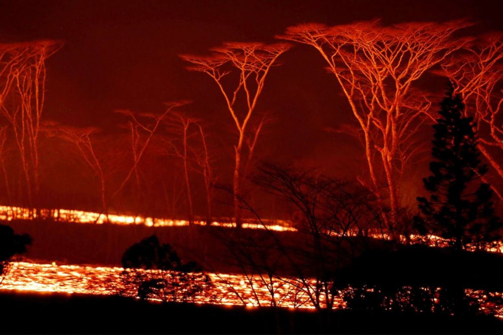 PHOTO: Lava flows on the outskirts of Pahoa during ongoing eruptions of the Kilauea Volcano in Hawaii, June 6, 2018.