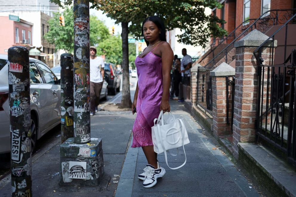 PHOTO: Nia Indigo, 23, a stylist based in New York, poses for a picture wearing a pair of Louis Vuitton Archlight sneakers in Brooklyn, New York, Sept. 2, 2018.