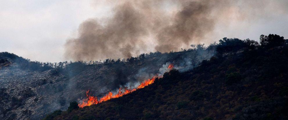 PHOTO: Flames and smoke rise as the Tenaja Fire burns near in Murrieta, Calif., Sept. 5, 2019.