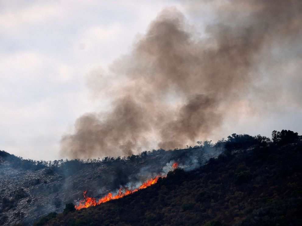 PHOTO: Flames and smoke rise as the Tenaja Fire burns near in Murrieta, Calif., Sept. 5, 2019.