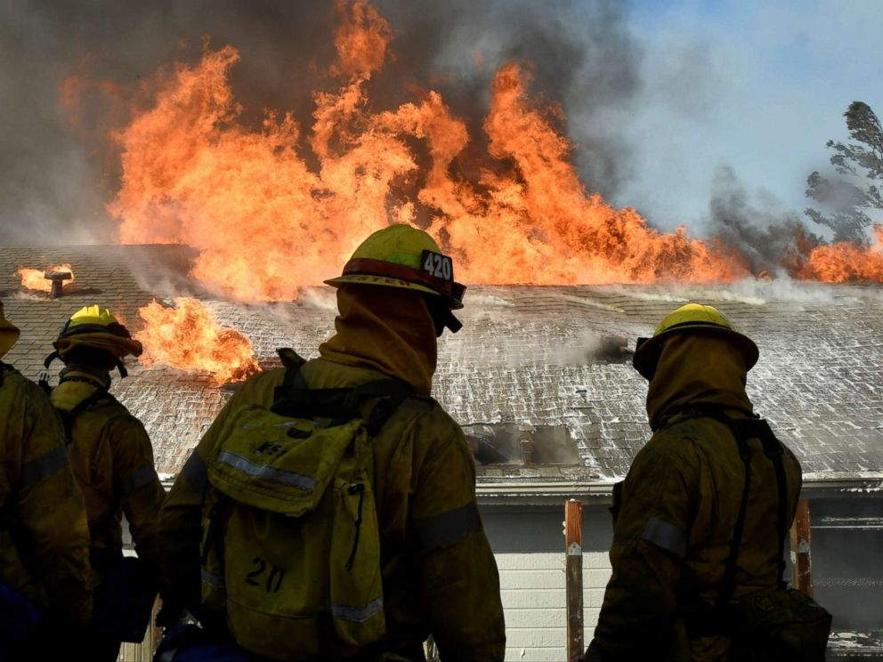 PHOTO: Firefighters battle to save one of many homes from a wildfire in Sylmar, Calif., Dec. 5, 2017.