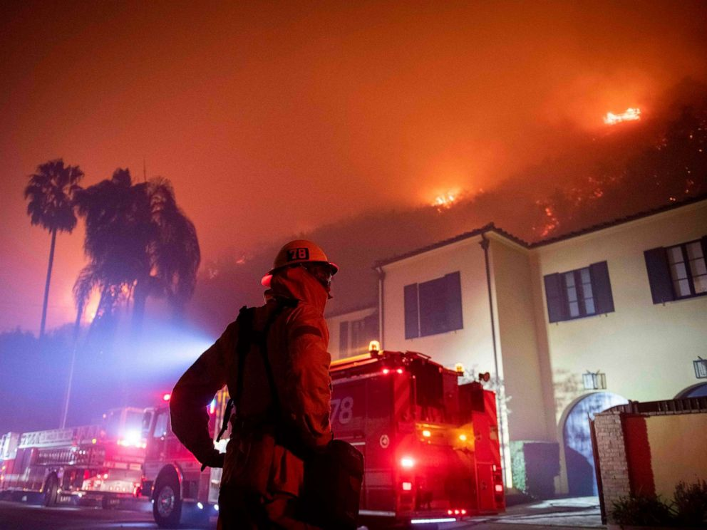 PHOTO: A firefighter watches as flames approach the Mandeville Canyon neighborhood during the Getty fire, Oct. 28, 2019, in Los Angeles.