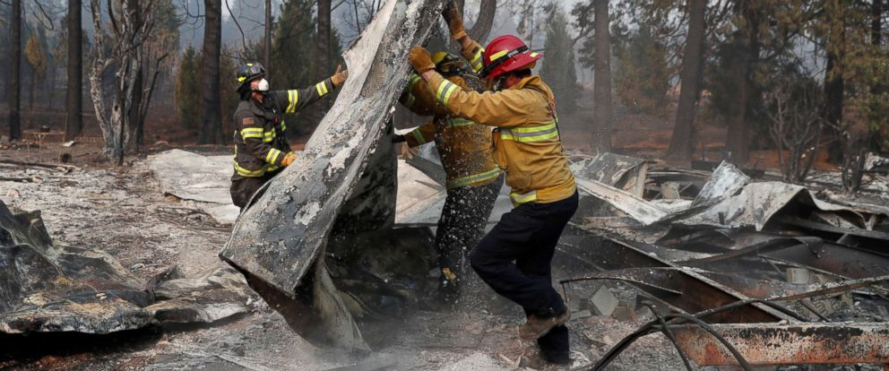 PHOTO: Firefighters move debris while recovering human remains from a trailer home destroyed by the Camp Fire in Paradise, Calif., Nov. 17, 2018.