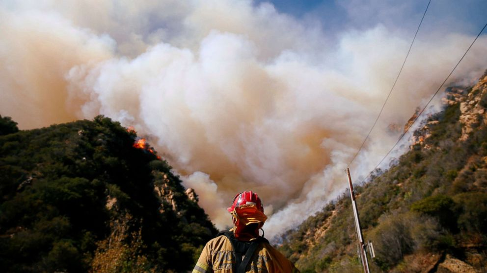 Firefighters battle the Woolsey Fire as it continues to burn in Malibu, Calif., Nov. 11, 2018.
