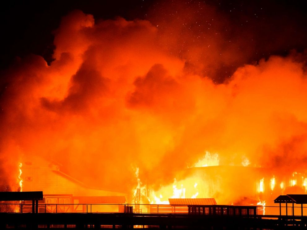 PHOTO: A wind-driven fire burns a structure on a farm during the Kincade fire in Windsor, Calif., Oct. 27, 2019.