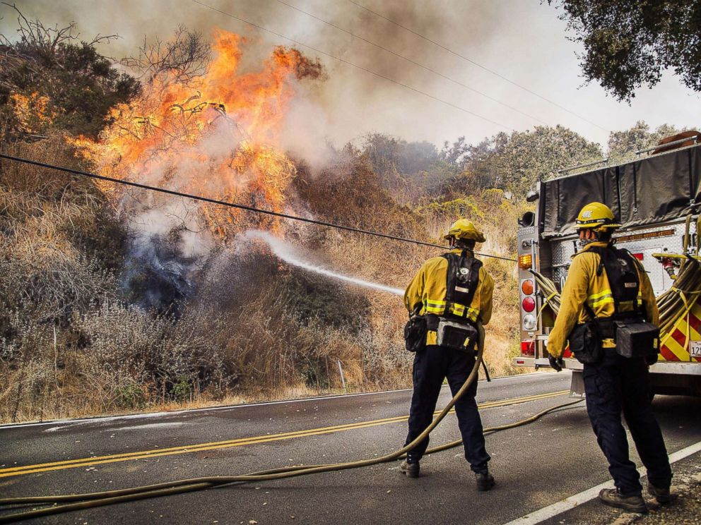 PHOTO: Firefighters battle flames on State Route 150 between Carpinteria and Ojai Calif., Dec. 11, 2017.