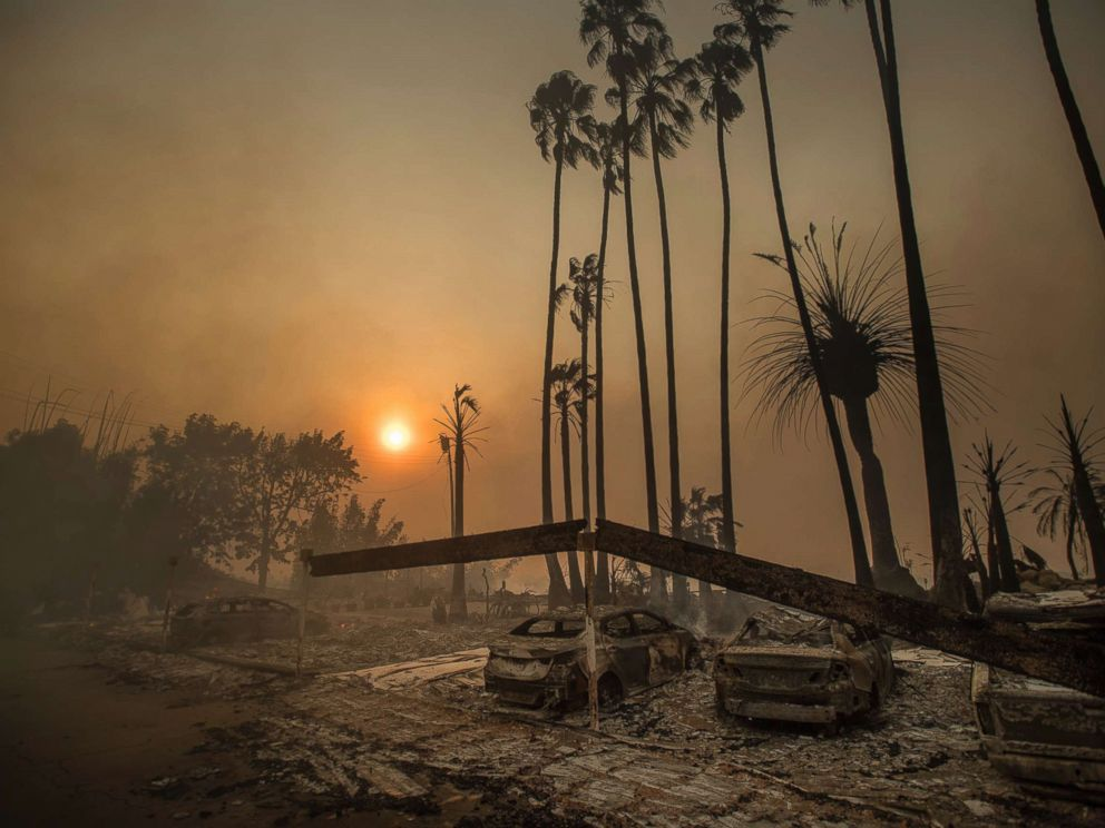 PHOTO: Smoke rises behind a leveled apartment complex as a wildfire burns in Ventura, Calif., Dec. 5, 2017
