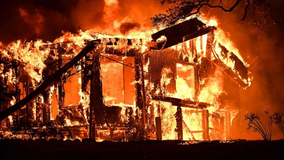 Flames ravage a home in the Napa wine region in California, Oct. 9, 2017, as multiple wind-driven fires continue to whip through the region.