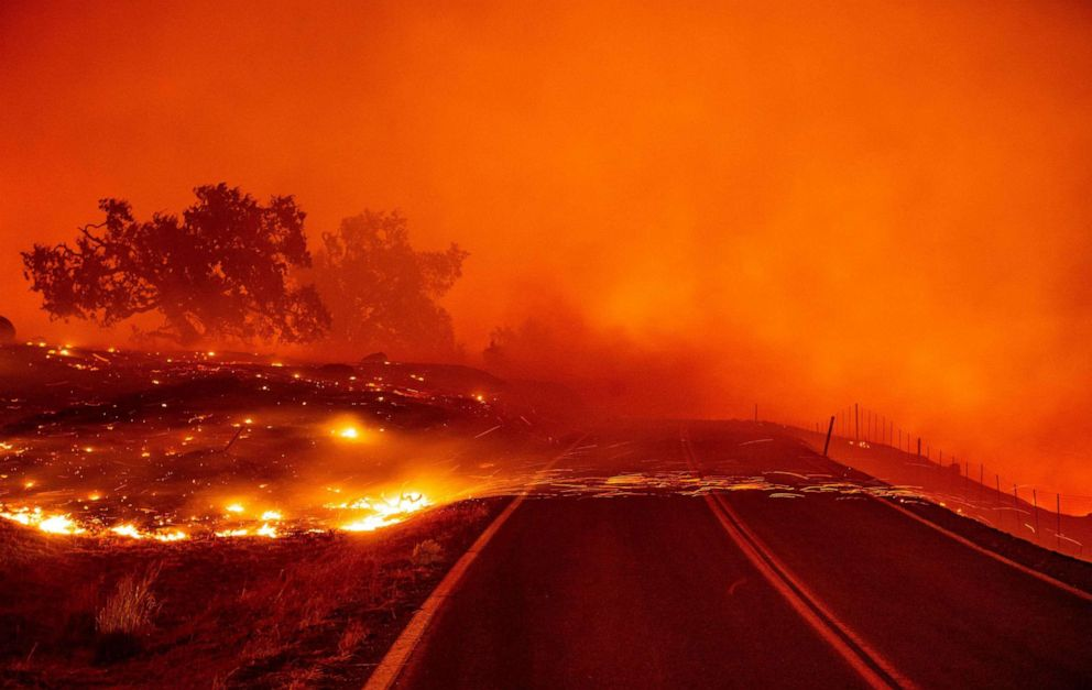 PHOTO: Embers blow across a road during the Kincade fire near Geyserville, Calif., Oct. 24, 2019.