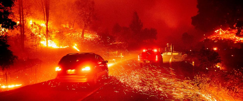 PHOTO: Embers fly across a roadway as the Kincade Fire burns through the Jimtown community of Sonoma County, Calif., Oct. 24, 2019.