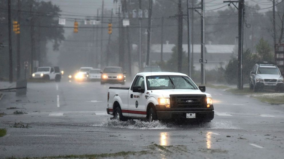 A vehicle with the Wilmington Fire Department drives through a flooded street from Florence, now a tropical storm in Wilmington, N.C., Saturday, Sept. 15, 2018.