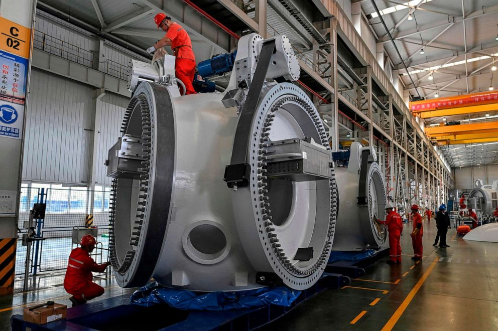 PHOTO: Workers at a plant during the production process of wind turbines during a government organized tour at Goldwind Technology in Yancheng, in Jiangsu province, Oct. 14, 2020.