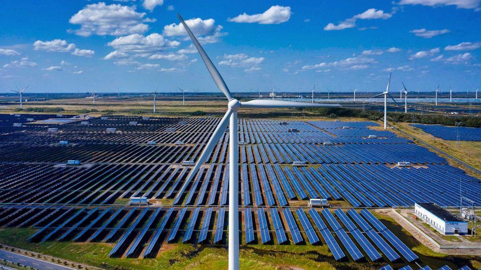 PHOTO: Solar panels and wind turbines of Wind, Solar and Fishing Base in Dongtai near Yancheng, Jiangsu province, China, Oct. 14, 2020.