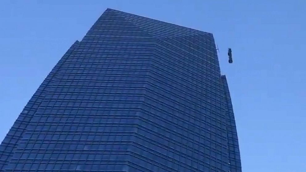This is TERRIFYING:' Wind-whipped window washers rescued