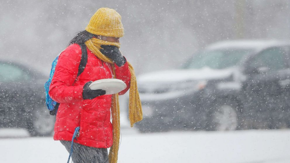 A pedestrian crosses the street during a snow storm in Boston, Mass., on Jan. 30, 2018.