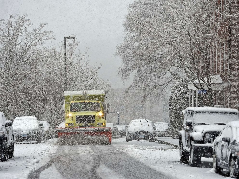 PHOTO: A Norwich, Conn., public works plow truck clears the street during a snow storm, March 13, 2018.