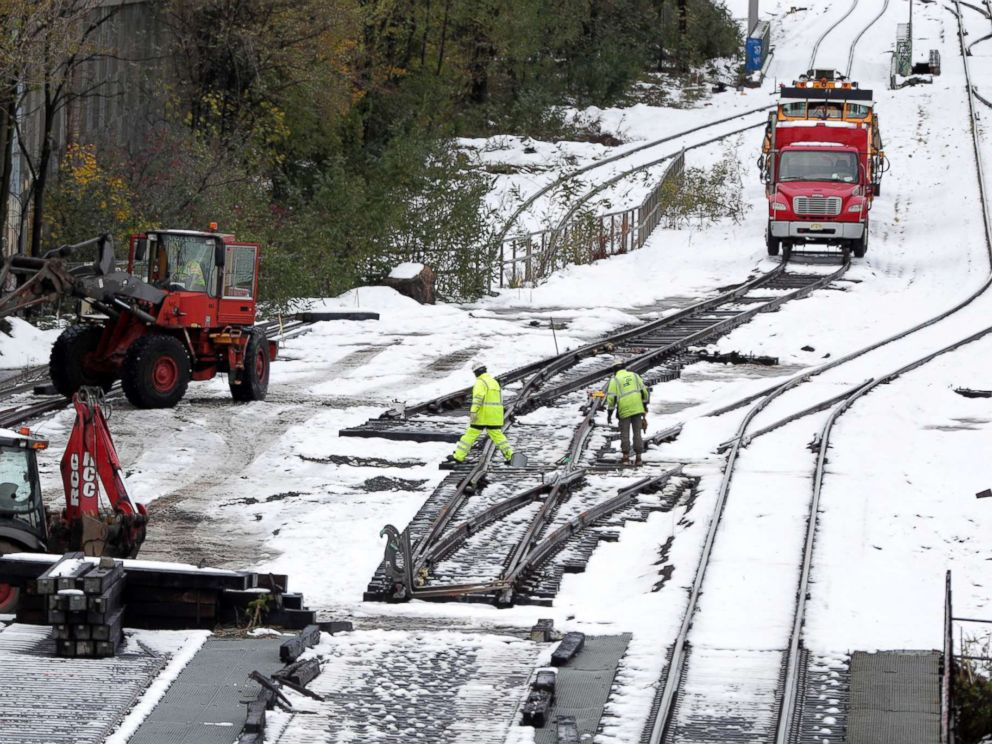 PHOTO: Workers inspect rail lines along Route 440 following a snowstorm, Friday, Nov. 16, 2018, in Jersey City, N.J.