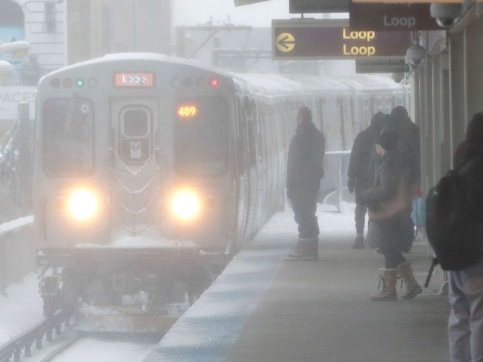 PHOTO: Snow is blown onto commuters while an arriving Chicago Transit Authority train arrives as a winter storm makes its way through several Midwest states, Feb. 9, 2018, in Chicago.