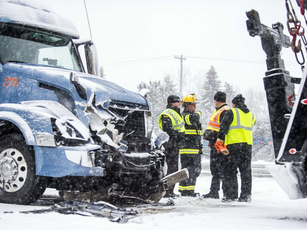 PHOTO: Emergency personnel work at the scene of a multiple vehicle crash along U.S. route 23 northbound, Feb. 9, 2018, in Fenton, Mich.