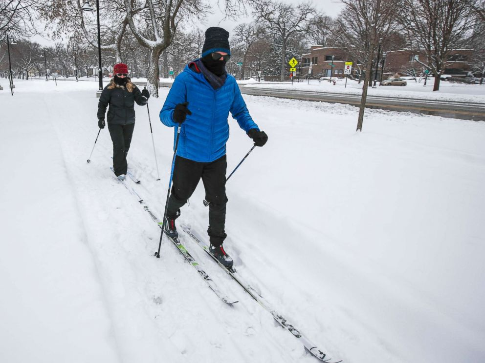 PHOTO: A couple glide along through a park on cross country skis as snow from a winter storm continues to fall in Evanston, Ill., Feb. 9, 2018.